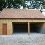 Étude, construction et montage de garages, ateliers et autres bâtiments en charpente bois lamellé collé et charpente mixte (bois lamellé collé et métal/béton) dans l'Orne (61), en Normandie / LEVEQUE S CHARPENTE